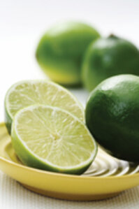 limes on a yellow plate