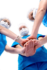 Physicians with hands in center