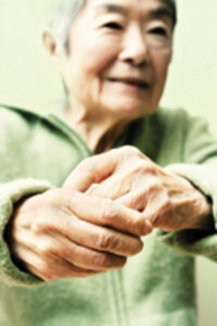 older woman wringing hands