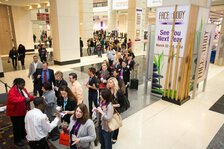Attendees line up to enter the Face & Body Midwest Spa Conference & Expo show floor.