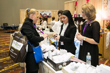 An attendee speaks with a exhibitors on the expo floor.