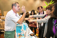 Attendees learn more from MindfulMinerals.com at their booth.