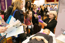 Dermatude USA performs a demonstration in their booth.