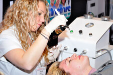 Clear Fx performs facial demonstrations with various machines to showcase new techniques.