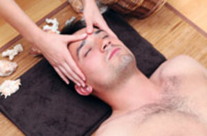 male professional skin care client getting massage