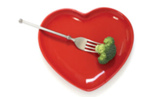 heart-shaped plate with forked broccoli