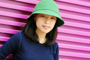 Girl wearing a green hat