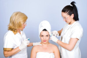 doctor and medical esthetician working with spa client