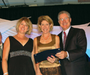 From left, Michele Pribble, marketing director, and Lisa Jenks, MD, medical director from Genesis Medspa accept the award from Jon Carrol for Excellence in Customer Service 2010.
