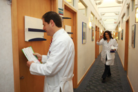 Dr. Schlessinger holds a chart in the hallway of his practice
