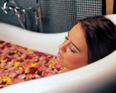 woman in flower-filled bathtub