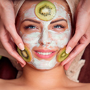 Woman receiving face mask esthetic treatment