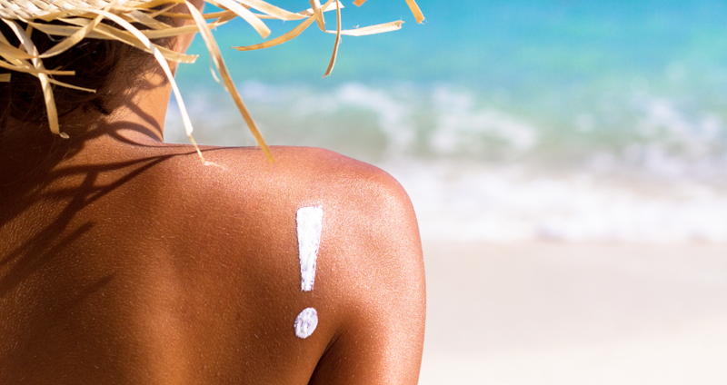 A shoulder with sunscreen on it