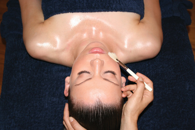 woman receiving facial