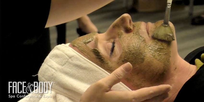 Someone receiving an exfoliation treatment