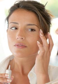 professional skin care client applying peptide-based serum