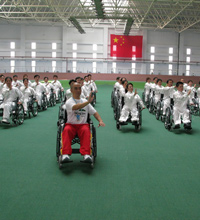 Dr. Zibin Guo demonstrates wheelchair Tai Chi
