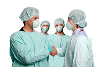 Group of surgeons, with two shaking hands