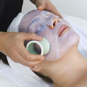 Meridian massage on a facial mask