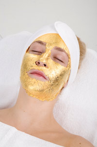 Woman in UMO 24 Karat Gold Facial