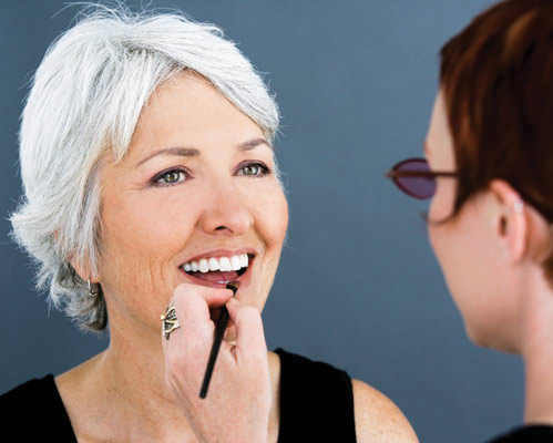 older woman getting lip liner applied