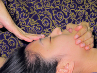 woman receiving Balinese massage