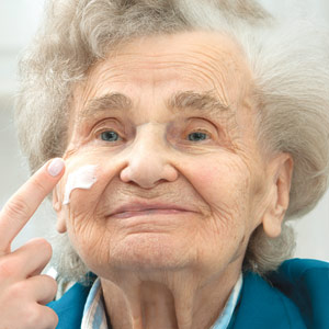 Elderly woman recieving a skin treatment