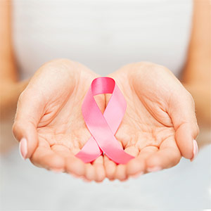 Breast cancer ribbon in hand