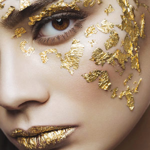 Woman with gold leaf on her face