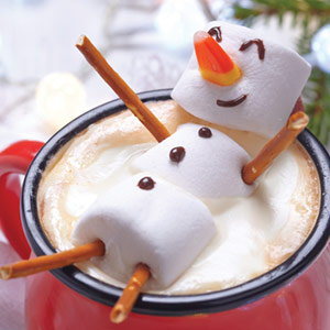A marshmallow snowman in a cup of coco
