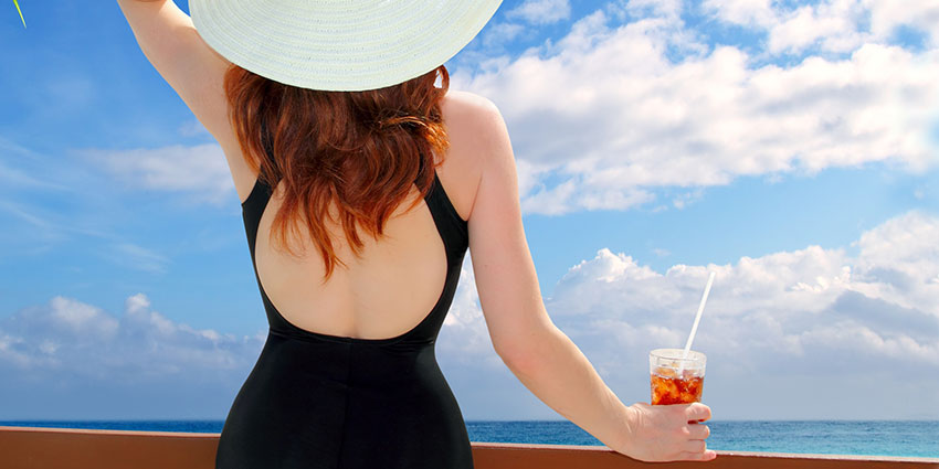 Woman in the summer sun with iced beverage
