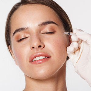 Facial injection treatment for young woman