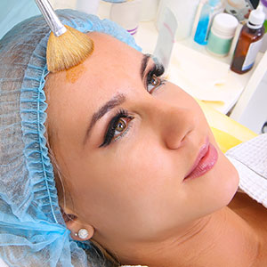 Woman receiving retinoid treatment