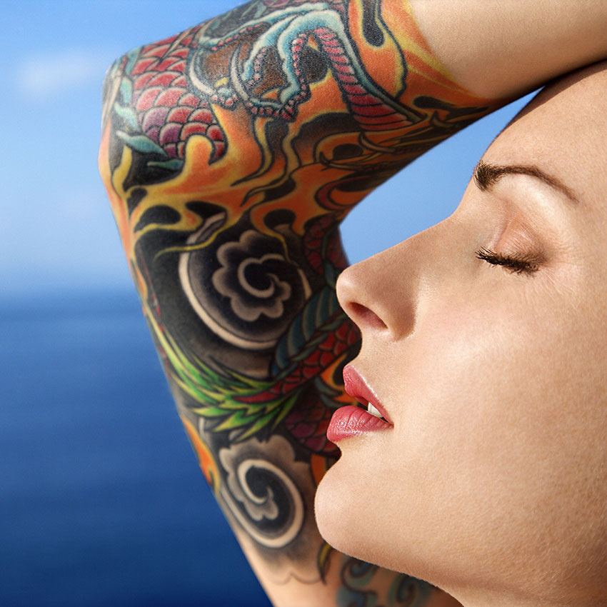Woman with arm tattoo