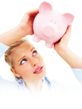 woman inspecting piggy bank