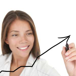 Woman drawing an arrow up.