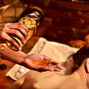 Young woman having oil massage spa treatment.