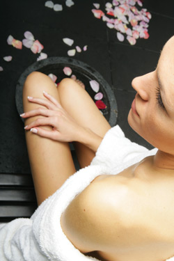 ariel view of woman with feet in pedicure bowl