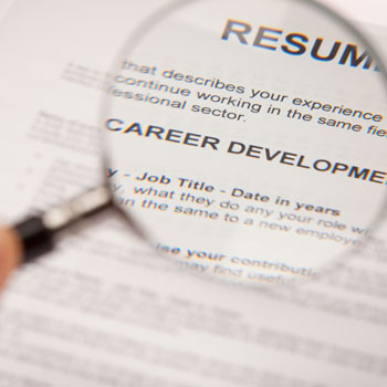 Magnifying glass on a resume