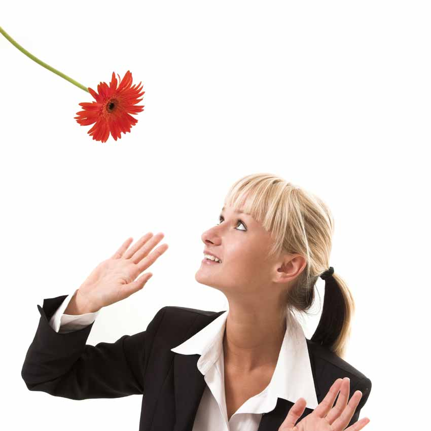 Biz woman with a red flower