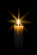 lit candle against dark background