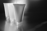 Three lotion bottles in black and white