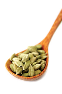 cardamom seeds in a wooden spoon