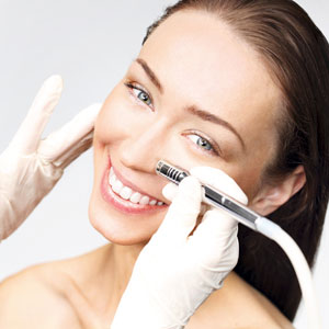 Woman getting microderm