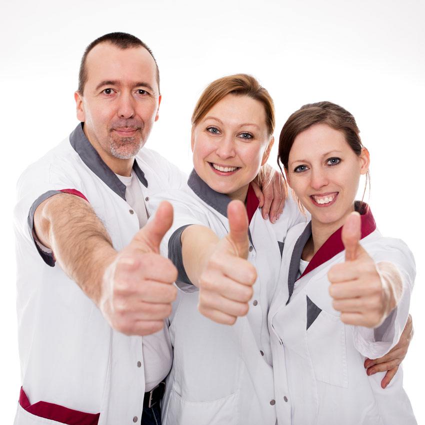 Spa employees giving a thumbs up