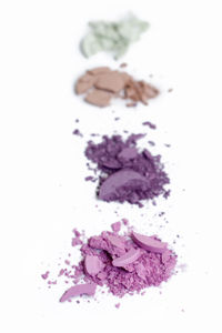 Four crushed eye shadows in different colors
