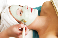 woman getting green facial mask