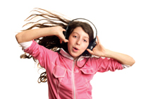 girl listening to music using headphones