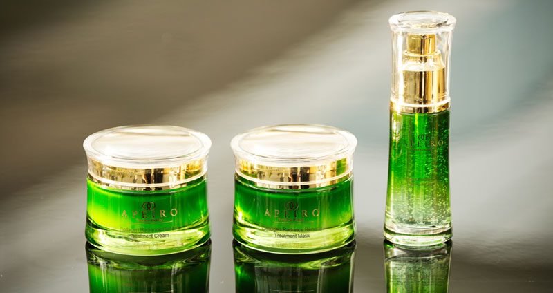 A picture of several viles of green liquid
