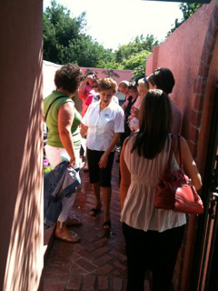 Gloria Maciel, owner of La Concha Spa, shows attendees the outdoor sauna during this Spa Tour.